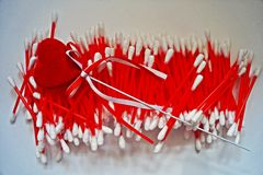 Cotton sticks. For ears in white and red tones Stock Photography