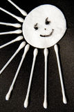 Cotton sun. Sun made of cotton disc and cotton sticks Stock Images