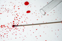 Cotton swab and blood drips in crime scene investigation Royalty Free Stock Image