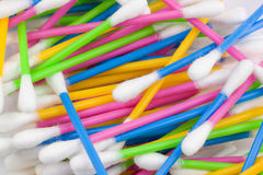 Cotton swabs. Bright colored cotton swabs background Royalty Free Stock Photography