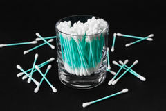 Cotton swabs in clear glass jar on black background Royalty Free Stock Photography