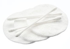 Cotton swabs and cotton pads. Royalty Free Stock Photo