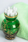 Cotton swabs in a green glass vase Stock Photos