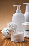 Cotton swabs and pads on wooden board Royalty Free Stock Photos