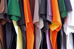 Cotton t-shirts. Row of colorful cotton t-shirts. Clothes background Royalty Free Stock Photography