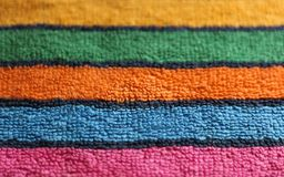 Cotton terry multicolored towel cloth fabric striped texture close up view background stock photo