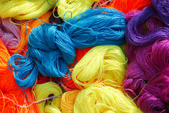 Cotton thread. The background of colorized cotton thread Stock Photos
