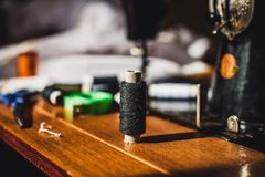Cotton thread coils for sewing. Cotton thread coil for sewing with a sewing machine on a background Stock Photography