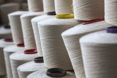 Cotton thread reel. Stacked together in a jeans factory Royalty Free Stock Image