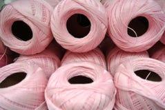 Cotton thread reel. The pink  cotton thread reel Stock Image