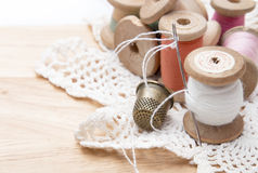 Cotton thread for sewing, wound on a wooden spool Royalty Free Stock Images