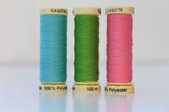 Cotton thread spool/reel - three in a row Royalty Free Stock Photo