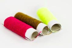 Cotton thread. On white background Royalty Free Stock Photos