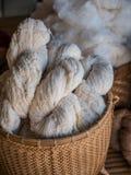 Cotton thread. White cotton thread in wicker basket Stock Photos