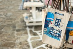 Tote bag souvenir for sale on street market, Greece stock images