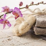Cotton towel and natural sponge for beauty massage. Loofah and towel for rejuvenation and femininity Stock Image