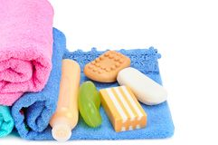 Cotton towels, cosmetic soap and shampoo isolated on white backg. Round. Free space for text Royalty Free Stock Image
