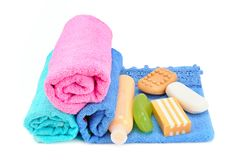 Cotton towels, cosmetic soap and shampoo  on white backg. Round. Free space for text Royalty Free Stock Photo