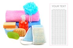 Cotton towels, cosmetic soap and shampoo isolated on white backg. Cotton towels, cosmetic soap, sponge and shampoo isolated on white background. Free space for Royalty Free Stock Photos