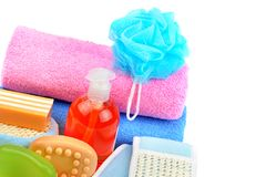 Towels, cosmetic soap and shampoo isolated on white background. Cotton towels, cosmetic soap, sponge and shampoo isolated on white background. Free space for Royalty Free Stock Photos