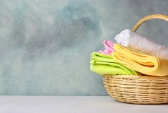 Cotton towels in a wicker basket. Laundry background. Copy space stock images