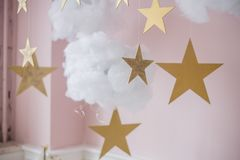 Cotton wadding clouds with stars on pink background Stock Photos