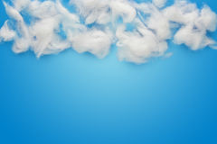 Cotton wool clouds over blue. Abstract background composed of white cotton wool clouds over blue royalty free stock images