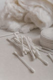 Cotton wool, cotton swabs and cotton disks. Cotton wool, cotton swabs and cotton disks on a gray background Stock Photo
