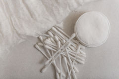 Cotton wool, cotton swabs and cotton disks. Cotton wool, cotton swabs and cotton disks on a gray background Royalty Free Stock Image