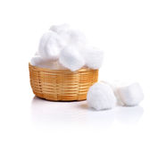 Cotton wool in samal basket on white background Stock Photos