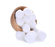 Cotton wool in wooden bowl isolated on a white background Royalty Free Stock Images