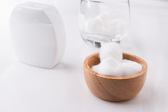 Cotton wool in wooden bowl. On white background Royalty Free Stock Photos