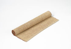 Cotton yarn place mat. Rolled cotton placemat on white background Royalty Free Stock Photos