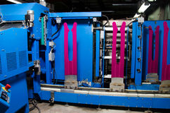 Cotton Yarn Production in a Textile Factory.nTextile fabric manufacturing machines in work. Royalty Free Stock Photography
