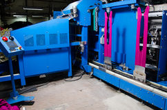 Cotton Yarn Production in a Textile Factory.nTextile fabric manufacturing machines in work. Stock Photo