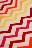 Colorful zigzag cotton fabric on wooden background stock photography