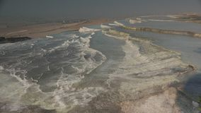 Cottony white pools at Hierapolis hot springs, Pamukkale, Turkey. 4k. White calcium travertines at Hierapolis hot springs, Pamukkale,Turkey. UNESCO World stock video footage