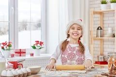 Cottura dei biscotti di Natale Fotografia Stock