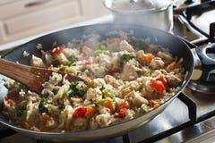 Cottura del risotto Immagine Stock
