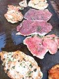 Cottura della bistecca Immagine Stock Libera da Diritti