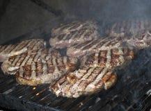 Cottura della bistecca di manzo Fotografie Stock