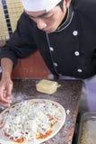 Cottura della pizza Immagini Stock Libere da Diritti