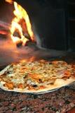 Cottura della pizza Fotografie Stock