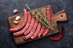 Cottura delle salsiccie fotografia stock