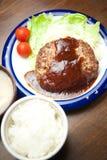Cottura domestica giapponese una bistecca di Amburgo Fotografie Stock