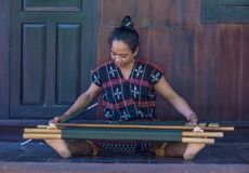 Cotu ethnic minority in Vietnam. QUANG NAM , VIETNAM - OCT 07 : Woman from the Cotu Minority weaves with a strap loom in Quang Nam Vietnam on October 07 2017 Royalty Free Stock Photography