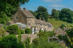 Cotwold stone cottages in the village of Minchinhampton, Gloucestershire, stock photo