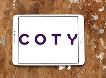 Coty beauty products manufacturer logo. Logo of Coty company on samsung tablet on wooden background. Coty is a North American beauty products manufacturer. Its royalty free stock photography