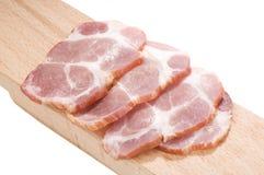 Cou cuit découpé en tranches de porc Images libres de droits