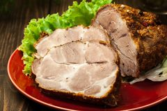 Cou rôti de porc avec des épices photo stock